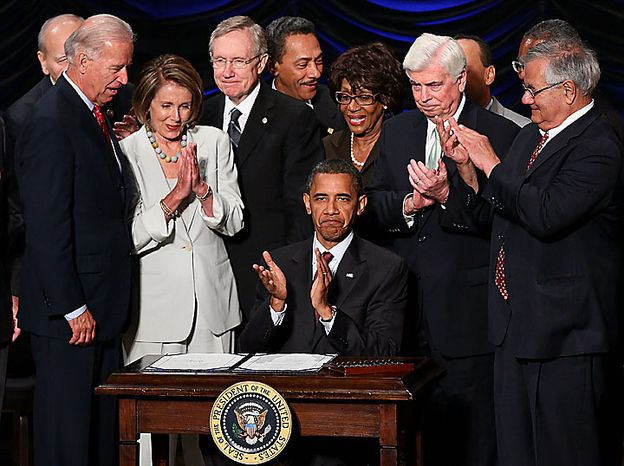 U.S. President Barack Obama signs the Dodd-Frank Wall Street Reform and Consumer Protection Act before (L-R) Vice President Joe Biden, Speaker of the House Nancy Pelosi (D-CA), Senate Majority Leader Harry Reid (D-NV), Rep. Maxine Waters (D-CA), Sen. Chris Dodd (D-CT) and Rep. Barney Frank (D-MA) at the Ronald Reagan Building July 21, 2010 in Washington, DC. The bill is the strongest financial reform legislation since the Great Depression and also creates a consumer protection bureau that oversees banks on mortgage lending and credit card practices   UPI/Win McNamee/Pool