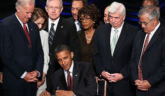** FILE ** U.S. President Barack Obama signs the Dodd-Frank Wall Street Reform and Consumer Protection Act at the Ronald Reagan Building, July 21, 2010, in Washington, D.C. Also pictured (L-R) are Vice President Joseph R. Biden, Speaker of the House Nancy Pelosi (D-CA), Senate Majority Leader Harry Reid (D-NV), Rep. Maxine Waters (D-CA), Sen. Chris Dodd (D-CT) and Rep. Barney Frank (D-MA). (UPI/Win McNamee/Pool)