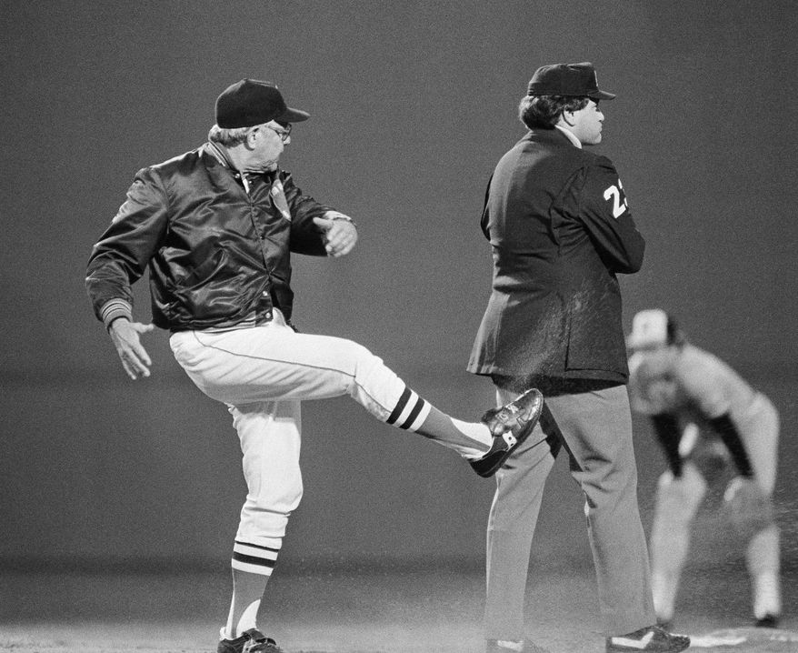 ASSOCIATED PRESS FILE - In this Sept. 16, 1983, file photo, Boston Rex Sox manager Ralph Houk, left, kicks dirt at umpire John Shulock after Shulock called Boston's Wade Boggs out at second base in a baseball game against the Baltimore Orioles at Fenway Park in Boston. The Red Sox say former manager Houk has died. He was 90. Red Sox spokesman Dick Bresciani says Houk died in Winter Haven, Fla., on Wednesday afternoon, July 21, 2010. The team heard from Houk's grandson, who lives in the Boston area. The cause of death was not immediately known.