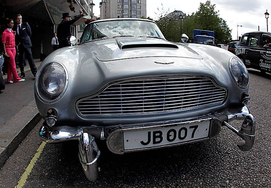 Complete with props that acted as hidden twin machine guns, the original Aston Martin DB5 driven by Sean Connery in the James Bond films Goldfinger and Thunderball is displayed for the media in London, Wednesday, July 21, 2010.  The car is estimated to fetch in the region of $4.6 million when it is sold at auction in London on Oct. 27.  (AP Photo/Matt Dunham)
