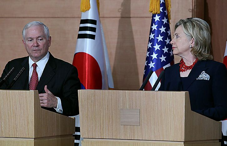 Secretary of Defense Robert Gates, left, with Secretary of State Hillary Clinton at a press conference with South Korean counterparts on Wednesday, July 21, 2010, in Seoul, South Korea. Mr. Gates and Mrs. Clinton are participating in talks with their Korean counter parts and South Korean President Lee Myung-Bak. (AP Photo/Mark Wilson, pool)