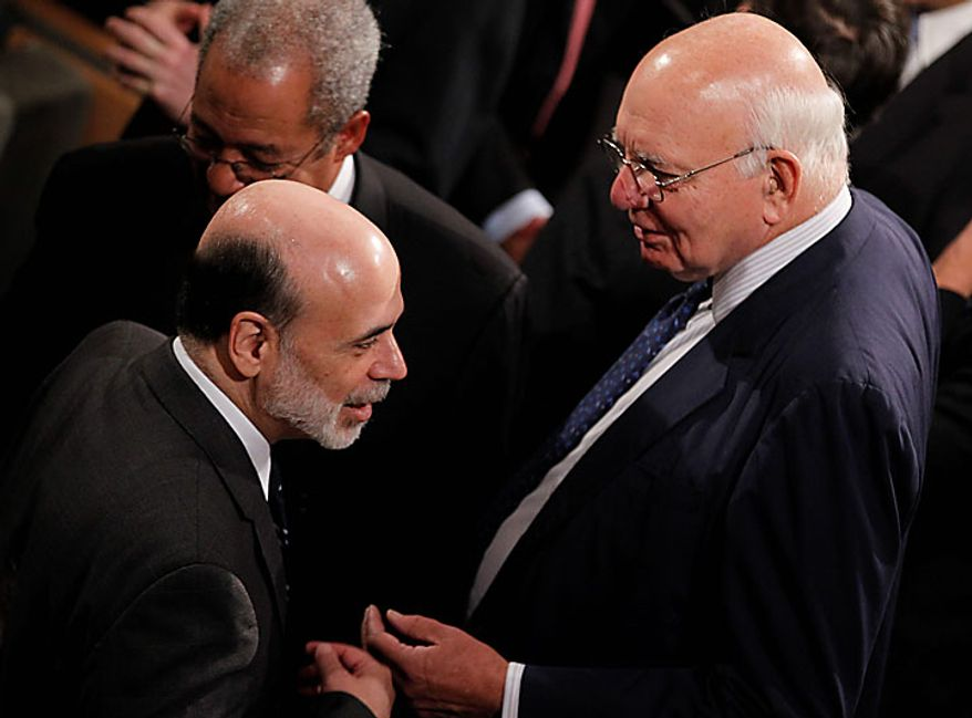 Federal Reserve Chairman Ben S. Bernanke (left) speaks with former Federal Reserve Chairman Paul Volcker before President Obama signs the Dodd-Frank Wall Street Reform and Consumer Protection Act at the Ronald Reagan Building and International Trade Center in Washington on Wednesday, July 21, 2010. (AP Photo/Charles Dharapak)