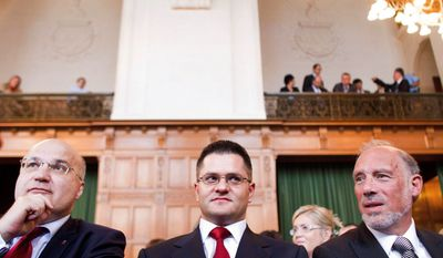 Associated Press Serbia's envoy to the Netherlands, Cedomir Radojkovic (left), and Serbian Minister of Foreign Affairs Vuk Jeremic (center) await a ruling on Kosovo's declaration of independence from the International Court of Justice in The Hague on Thursday.