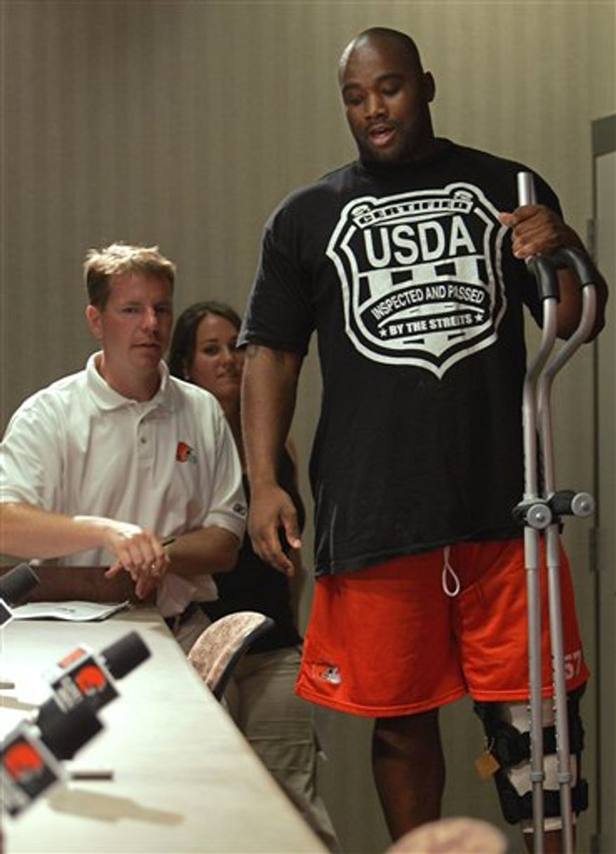 FILE - In this Aug. 2, 2006 file photo, Cleveland Browns center LeCharles Bentley arrives for a news conference at the NFL football team's football training camp in Berea, Ohio. Bentley suffrered a season-ending knee injury suffered in the second day of practice. Former Browns center Bentley has filed a lawsuit against the team over a career-ending staph infection he says he contracted at the team's facility. (AP Photo/Mark Duncan, File)