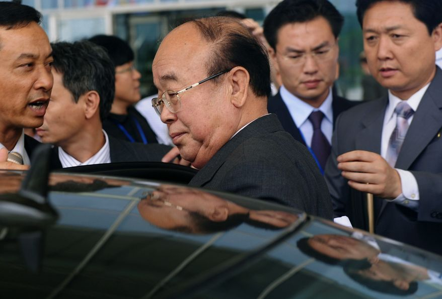 North Korean Foreign Minister Pak Ui Chun (center), surrounded by Vietnamese security staff, gets into a limousine to leave the main venue of the ASEAN Regional Forum in Hanoi on Thursday, July 22, 2010. The North Korea's top diplomat is on a damage-control mission this week at the Asian security meeting, pleading innocence in the sinking of a South Korean warship that killed 46 sailors and has been widely blamed on Pyongyang, an analyst said Wednesday. (AP Photo/Hoang Dinh Nam, Pool)