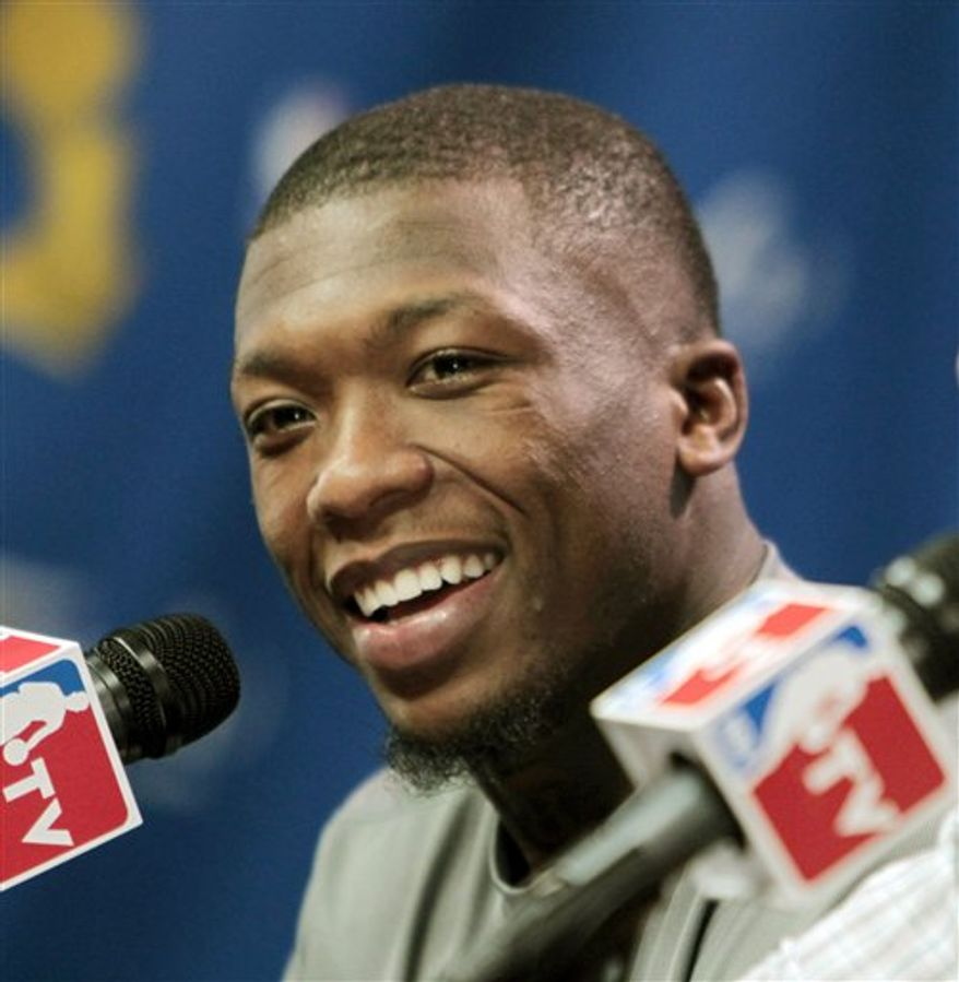 FILE - This June 11, 2010, file photo shows Boston Celtics guard Nate Robinson during a news conference after Game 4 of the NBA basketball finals between the Celtics and the Los Angeles Lakers,  in Boston.  The Boston Celtics have re-signed guard Nate Robinson. (AP Photo/Michael Dwyer, File)