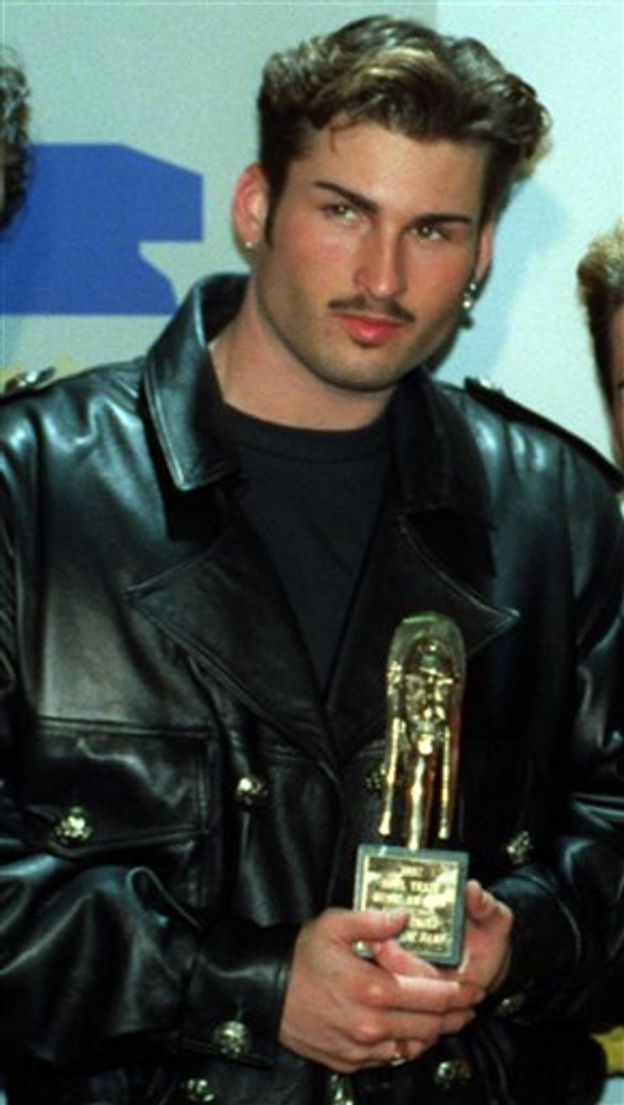 "FILE - Bryan Abrams poses backstage at the Sixth Annual Soul Train Awards where his group, ""Color Me Badd,"" won an award for Best R&B/Soul Single by a Group, in Los Angeles, in this March 10, 1992 file photo. Honolulu police say 40-year-old Bryan Abrams was arrested Tuesday July 20, 2010 after getting into an argument with his wife and throwing her across the room. (AP Photo/Doug Pizac, File)"