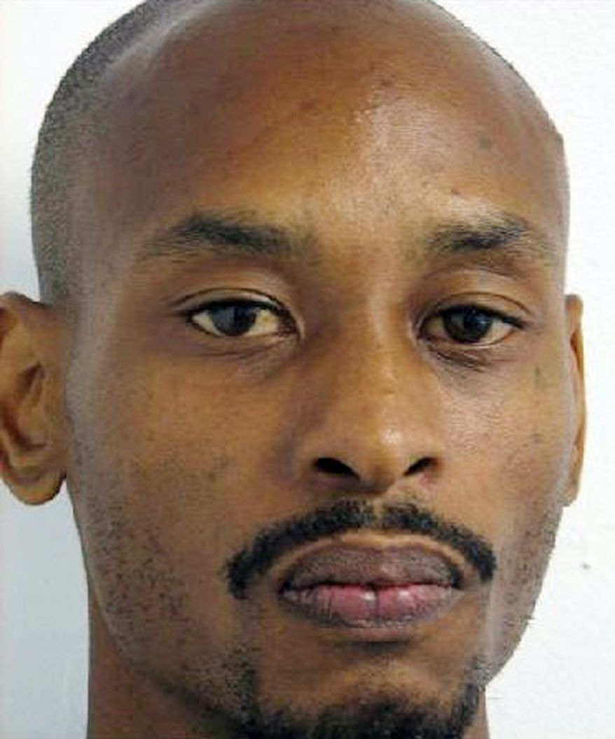 This undated booking mug shot released by the Montgomery County Police Department, Montgomery County, Md., shows Raymond L. Williams. Williams, who is accused of killing Azin Naimi, a resident of Rockville, Md. The woman's body was found Monday afternoon in Washington, D.C. after a relative reported her missing. (AP Photo/Montgomery County Police Dept., HO)