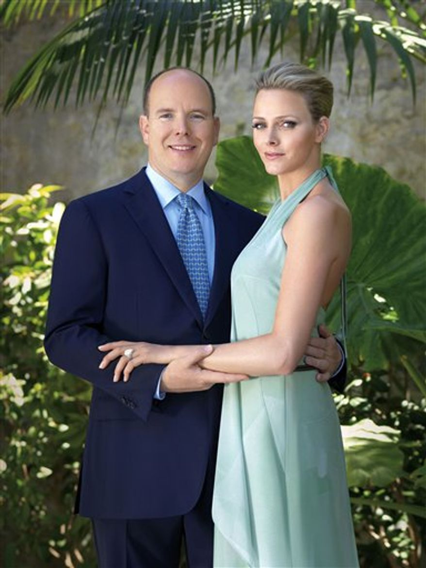 FILE - This photo of June 23, 2010 provided by the Monaco Palace shows Prince Albert and South Africa's Charlene Wittstock. The royal palace in Monaco says Prince Albert II will tie the knot with his future bride in July 2011. The palace in the Riviera principality said Thursday July 22, 2010 that the two have set a date for a religious ceremony: July 9, 2011. A civil ceremony will take place the day earlier.  (AP Photo/Amedeo M Turello/ Monaco Palace, File)