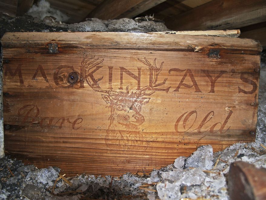 In this undated photo provided by Antarctic Heritage Trust via the Canterbury Museum, a whisky crate is stored beneath the floor of a hut built by British explorer Sir Ernest Shackleton during his 1908 Antarctic expedition. The crate of Scotch whisky that has been frozen in Antarctic ice for more than a century is being slowly thawed by New Zealand museum officials, for analysis, not to be tasted. (AP Photo/Antarctic Heritage Trust via the Canterbury Museum, Paul Terry)