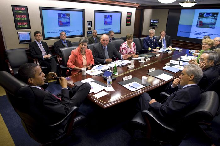 In this image released by the White House, President Obama receives a briefing in the Situation Room of the White House on the BP oil spill in the Gulf of Mexico, on Wednesday, July 21, 2010. Taking part in the meeting are, clockwise from top; Homeland Security Secretary Janet Napolitano, National Incident Commander Adm. Thad Allen, Environmental Protection Agency Administrator Lisa P. Jackson, U.S. Cost Guard Rear Adm. Peter Neffenger, Press Secretary Robert Gibbs, Interior Secretary Ken Salazar, NOAA Administrator Jane Lubchenco, Energy Secretary Steven Chu and Chief of Staff Rahm Emanuel. (AP Photo/Pete Souza)