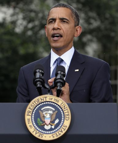 """In this July 15, 2010, file photo President Obama speaks to reporters outside the Oval Office of the White House in Washington. On Thursday, July 22, 2010, Mr. Obama signed into law the """"Improper Payments Elimination and Recovery Act,"""" which he said will reduce waste and fraud in government spending. (AP Photo/Carolyn Kaster, File)"""