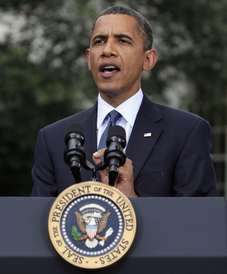 "In this July 15, 2010, file photo President Obama speaks to reporters outside the Oval Office of the White House in Washington. On Thursday, July 22, 2010, Mr. Obama signed into law the ""Improper Payments Elimination and Recovery Act,"" which he said will reduce waste and fraud in government spending. (AP Photo/Carolyn Kaster, File)"