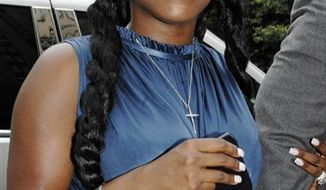 FILE - In this Wednesday, Aug, 22, 2007 picture, Foxy Brown, whose birth name is Inga Marchand, enters Manhattan criminal court, in New York. (AP Photo/ Louis Lanzano)