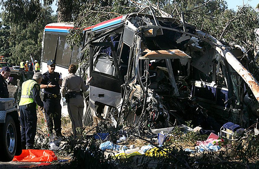 California Highway Patrol investigators work at the scene of the fatal Greyhound bus accident in which at least six people were killed and others injured Thursday, July 22, 2010, in Fresno, Calif. A Greyhound bus traveling to Sacramento from Los Angeles crashed on a highway in California's Central Valley early Thursday morning. (AP Photo/The Fresno Bee, John Walker)