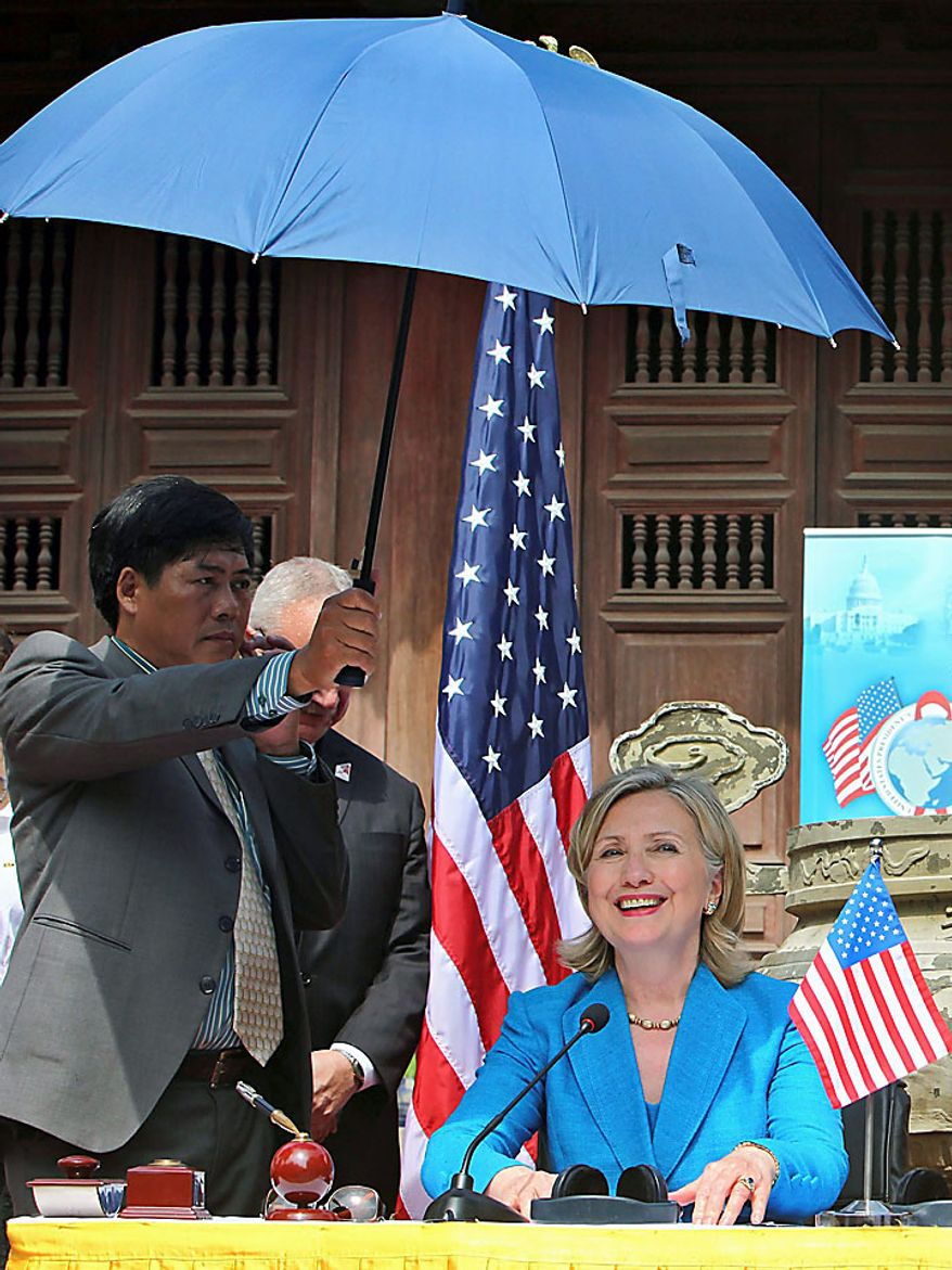 U.S. Secretary of State Hillary Rodham Clinton attends a signing ceremony for a memorandum of understanding for U.S. support of HIV/AIDS programs in Vietnam, at Ngoc Lam Pagoda in Hanoi, Vietnam, Thursday, July 22, 2010. (AP Photo/Julian Abram Wainwright, Pool)