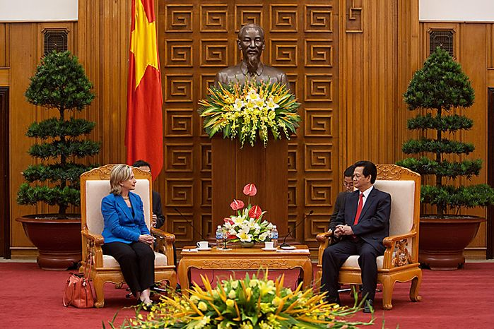 "Hillary Clinton, U.S. secretary of state, left, and Nguyen Tan Dung, Vietnam's prime minister, meet at the Office of the Prime Minister in Hanoi, Vietnam, on Thursday, July 22, 2010. The U.S. is ready to take relations with Vietnam to a ""new level"" 15 years after establishing diplomatic ties with its former adversary, Secretary of State Clinton said. (Photographer: Nelson Ching/Bloomberg)"