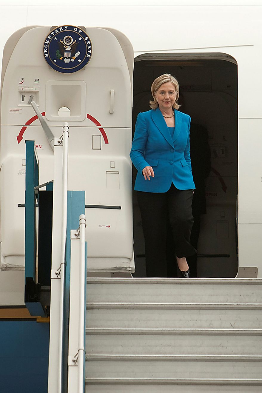 Hillary Clinton, U.S. secretary of state, arrives at Noi Bai International Airport in Hanoi, Vietnam, on Thursday, July 22, 2010. The U.S. said it will intensify sanctions against North Korea for sinking a South Korean warship, targeting members of Kim Jong Il's regime and the foreign banks that help sustain the country's weapon's industry. (Photographer: Nelson Ching/Bloomberg)