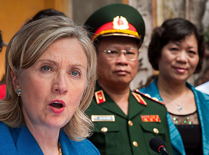 U.S. Secretary of State Hillary Rodham Clinton, left, delivers remarks after signing a framework agreement for the U.S. Presidents Emergency Plan for Aids Relief with Vietnam Minister of Justice Ha Hung Cuong, right, at Ngoc Lam Pagoda in Hanoi, Vietnam, Thursday, July, 22, 2010. (AP Photo/Paul J. Richards, Pool)