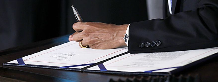 A close-up as President Obama signs the Improper Payments Elimination and Recovery Act in a ceremony in the State Dining Room of the White House in Washington, Thursday, July 22, 2010. (AP Photo/Pablo Martinez Monsivais)