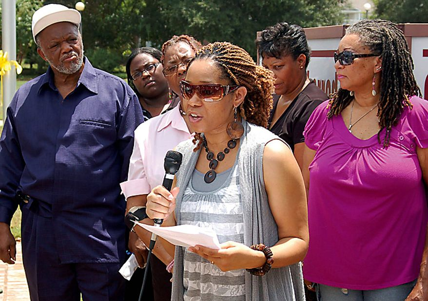 Mikhiela Sherrod, daugher-in-law of Shirley Sherrod, speaks during a rally in Albany, Ga., Wednesday, July 21, 2010. The White House did a sudden about-face Wednesday and begged for forgiveness from the black Agriculture Department employee whose ouster ignited an embarrassing political firestorm over race. (AP Photo/The Albany Herald, Terry Lewis)