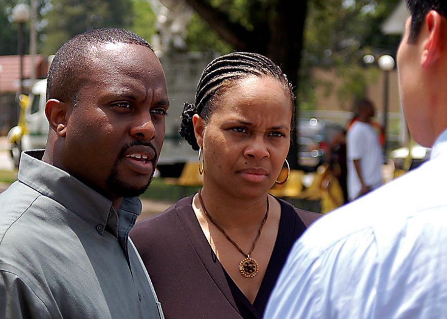 Kenyatta Sherrod, left, and Russia Sherrod, the children of Shirley Sherrod, speak to a reporter after a rally in support for their mother on Wednesday, July 21, 2010, in Albany, Ga. The White House did a sudden about-face Wednesday and begged for forgiveness from the black Agriculture Department employee whose ouster ignited an embarrassing political firestorm over race. (AP Photo/The Albany Herald, Terry Lewis)