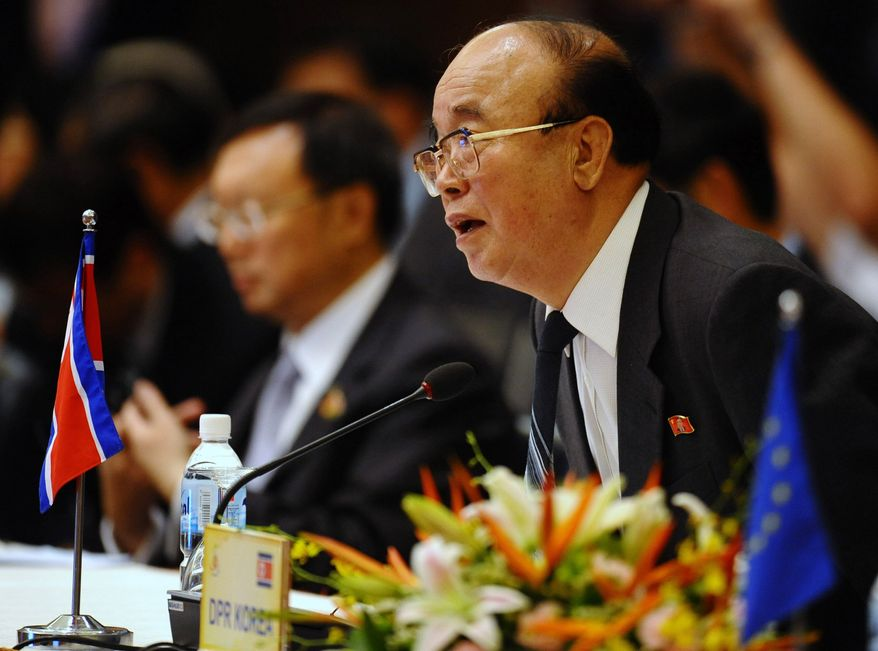 North Korean Foreign Minister Park Ui Chun sits down next to his Chinese counterpart Yang Jiechi as they attend the plenary session of the ASEAN Regional Forum (ARF) in Hanoi, Vietnam, Friday, July 23, 2010. (AP Photo/Hoang Dinh Nam, Pool)