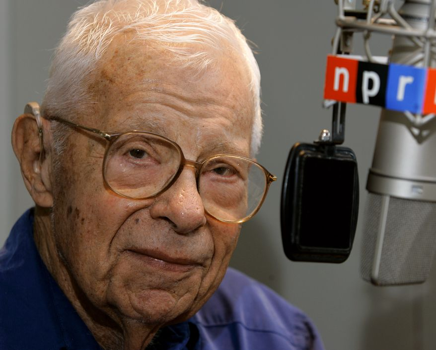 In this Oct. 3, 2005, file photo, veteran reporter and commentator Daniel Schorr sits at the microphone in the studios of National Public Radio in Washington. (AP Photo/J. Scott Applewhite, file)