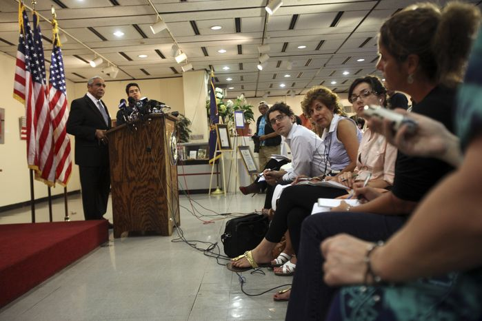 Democratic Rep. Charles B. Rangel, left, speaks to reporters during a news conference Friday, July 23, 2010 in New York. Rangel, once among the most powerful members of Congress, will face a hearing on charges of violating House ethics rules after a panel of his peers formally accused him of wrongdoing Thursday. (AP Photo/Mary Altaffer)