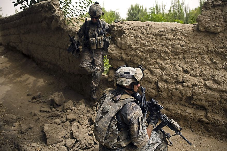 A U.S. Army soldier provides cover during a patrol by the 1-320th Alpha Battery, 2nd Brigade of the 101st Airborne Division near COP Nolen, in the volatile Arghandab Valley, Kandahar, Afghanistan, Friday, July 23, 2010. (AP Photo/Rodrigo Abd)