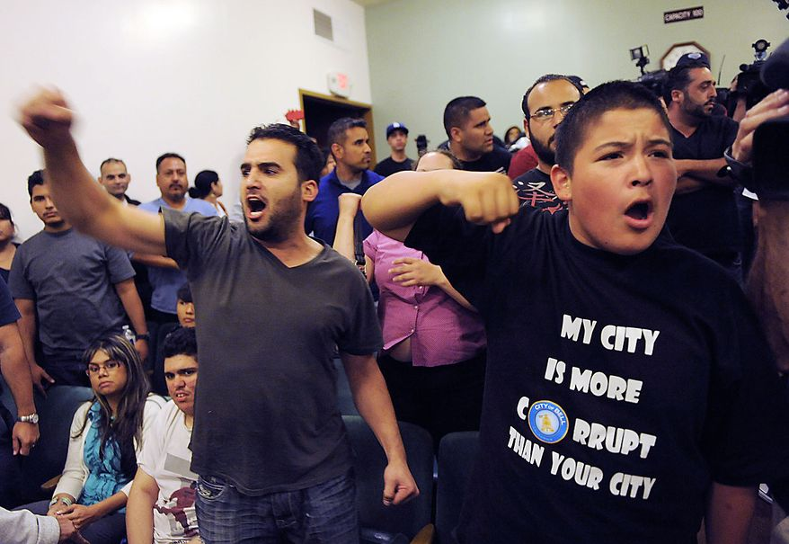 Bell, Calif. residents Hussein Saleh, left, and Eddie Delgado call for the ouster of city officials during a special meeting of the Bell City Council, Thursday, July 22, 2010, in Bell, Calif. Bell's police chief and two top city administrators agreed to resign Thursday night during a closed-door meeting at City Hall. Revelations about Bell city leaders' pay has sparked anger in a blue-collar town that is one of the poorest in Los Angeles County. (AP Photo/Chris Pizzello)
