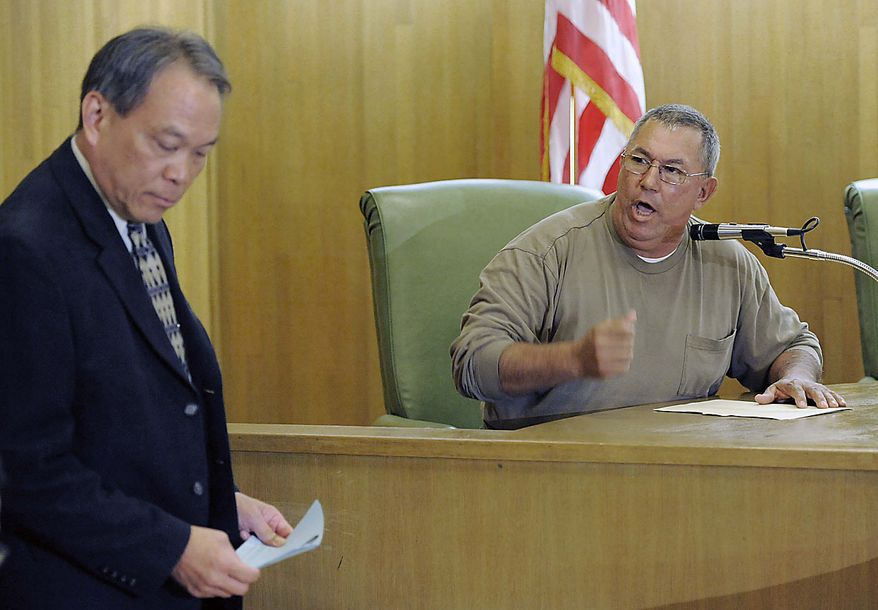 Lorenzo Velez, right, a Bell city counselor, argues with city attorney Ed Lee during a special city council meeting in Bell, Calif., Thursday, July 22, 2010. Velez was arguing for an open-to-the-public session, while Lee called for a closed session. Revelations about Bell city leaders' pay has sparked anger in a blue-collar town that is one of the poorest in Los Angeles County. (AP Photo/Chris Pizzello)