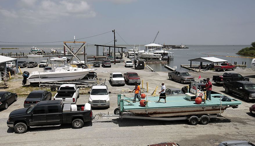 Boaters take their boats out of the water in Grand Isle, La., Friday, July 23, 2010 in anticipation of Tropical Storm Bonnie making landfall sometime Saturday along the Louisiana coast. BP has recalled much of the oil skimming efforts in anticipation of bad weather. (AP Photo/Dave Martin)