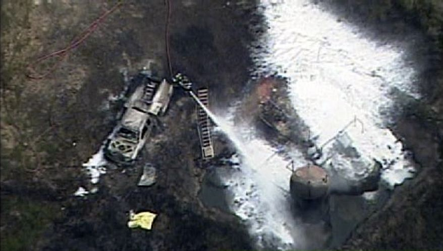 In this frame grab image provided by video from WPXI-TV, personnel battle a fire rustling from a natural gas well explosion in Indianola, Pa., northeast of Pittsburgh on Friday, July 23, 2010. Police reported two persons killed. (AP Photo/WPXI)