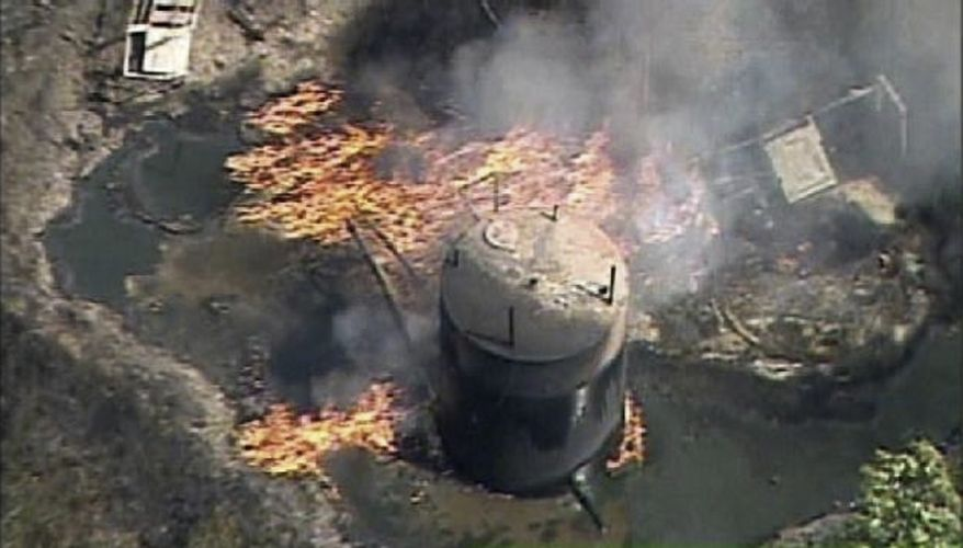 In this frame grab image provided by video from WPXI-TV, a fire rustling from a natural gas well explosion burns in Indianola, Pa., northeast of Pittsburgh on Friday, July 23, 2010. Police reported two persons killed. (AP Photo/WPXI)