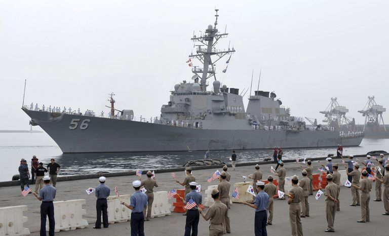 """The U.S. Navy's Aegis destroyer USS John S. McCain (DDG-56), arrives for joint U.S.-South Korean military exercises at Donghae Harbor, South Korea, Saturday, July 24, 2010. North Korea warned Saturday that joint U.S. and South Korean military exercises poised to begin this weekend amount to a military provocation that will draw a """"powerful"""" nuclear response from Pyongyang. (AP Photo/Yonhap)"""