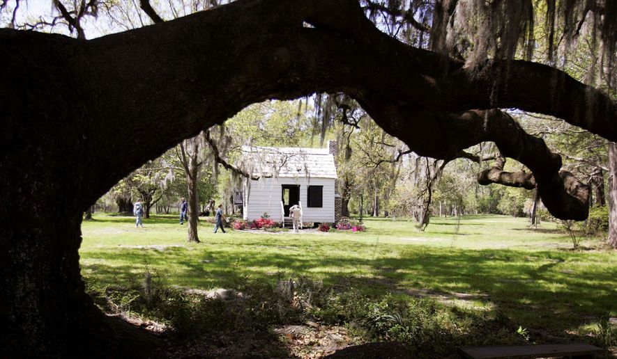 The gardener's home is part of a tour of the newly restored slave cabins at Magnolia Plantation and Gardens near Charleston, S.C. The state once had thousands of slave cabins, and historian Joe McGill is trying to encourage local efforts to save the ones that are left. (Associated Press)