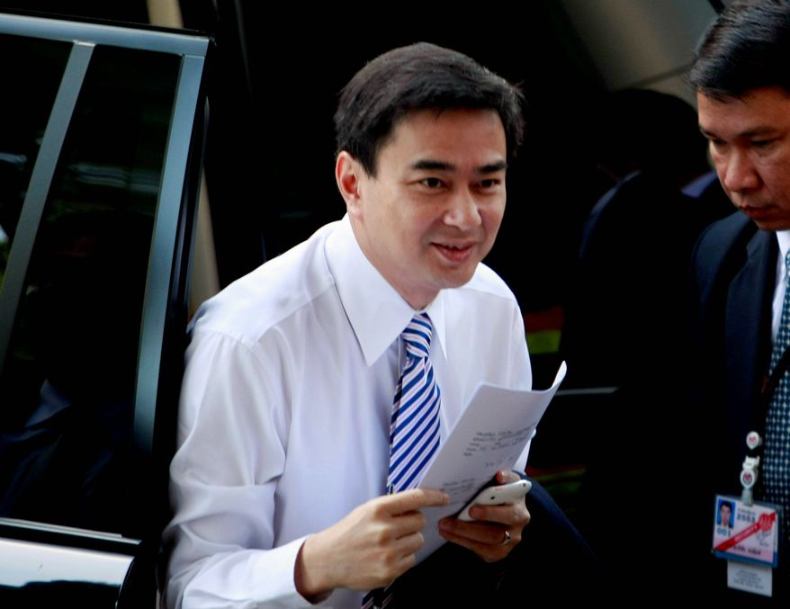 Thai Prime Minister Abhisit Vejjajiva arrives at criminal court in Bangkok on Thursday. Mr. Abhisit is facing two corruption cases that could unseat him and dissolve his political party. (Associated Press)