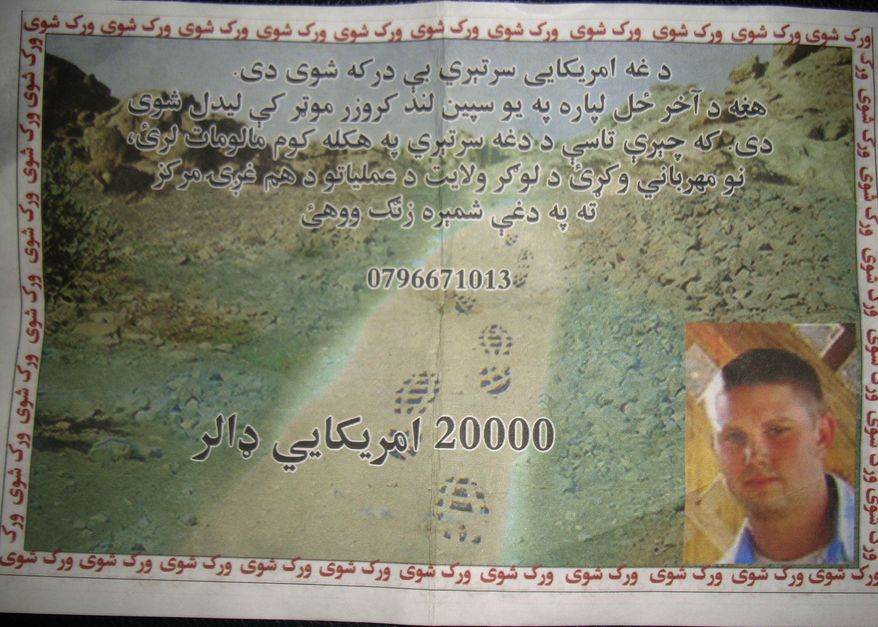 """A leaflet distributed by the U.S. military to civilians in Logar province, east of Kabul, Afghanistan, on Sunday, July 25, 2010, shows a missing U.S. Navy sailor with an offer of a $20,000 reward for information on his whereabouts. The leaflet reads: """"This American troop is missing. He was last seen in a white Land Cruiser vehicle. If you have any information about this solider, kindly contact the Logar Joint Coordination Center."""" U.S. and NATO officials confirmed that two American Navy personnel went missing Friday in the eastern province of Logar after an armored sport utility vehicle was seen driving into a Taliban-held area. (AP Photo)"""