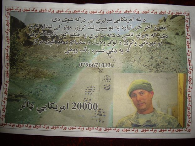 """A leaflet distributed Sunday by the U.S. military to civilians in Logar province, east of Kabul, Afghanistan, shows a missing U.S. Navy sailor with an offer of a $20,000 for information on his whereabouts. The leaflet reads: """"This American troop is missing. He was last seen in a white Land Cruiser vehicle. If you have any information about this solider, kindly contact the Logar Joint Coordination Center."""" U.S. and NATO officials confirmed that two American Navy personnel disappeared Friday in the eastern province of Logar, after an armored sports utility vehicle was seen driving into a Taliban-held area. (Associated Press)"""