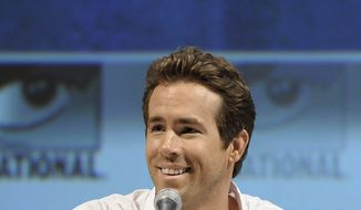 "Actor Ryan Reynolds speaks at a panel discussion of his feature film ""Green Lantern"" at Comic Con in San Diego, Calif. on Saturday, July 24, 2010. (AP Photo/Dan Steinberg)"