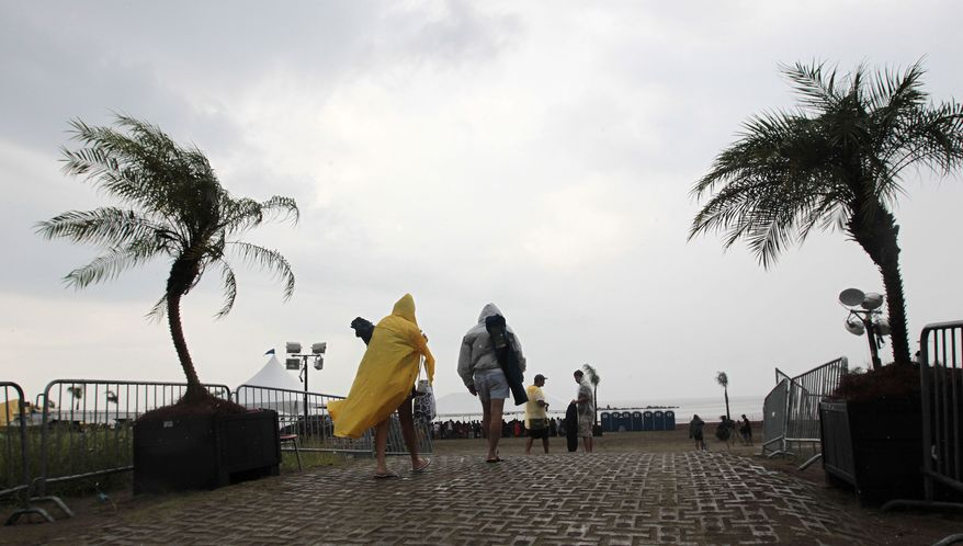 Music fans arrive at the Island Aid 2010 concert on the beach at Grand Isle, La., as Tropical Depression Bonnie approaches the coast on Saturday, July 24, 2010. (AP Photo/Dave Martin)