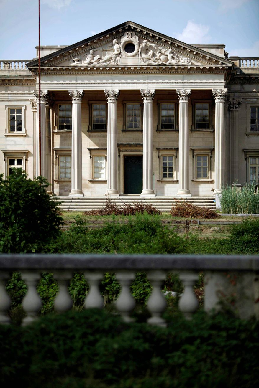 """Lynnewood Hall in Elkins Park, Pa., faces an uncertain future. The mansion, just outside of Philadelphia, was home to the uber-wealthy Widener family and called """"the last of the American Versailles."""" The 70,000-square-foot Georgian-style palace designed by architect Horace Trumbauer has 110 rooms. (Associated Press)"""