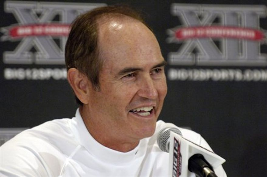 Baylor University head football coach Art Briles answers reporters questions during a press conference at the 2010 Big 12 Football Media Day Monday, July 26, 2010 in Irving, Texas. (AP Photo/Cody Duty)