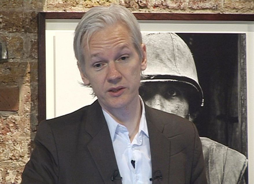 Wikileaks founder Julian Assange speaks during a press conference in London on Monday, July 26, 2010, during which he said he believes there is evidence of war crimes in the thousands of pages of leaked U.S. military documents relating to the war in Afghanistan. (AP Photo/Lizzie Robinson, PA)