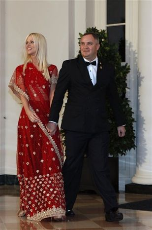 """FILE - In this Tuesday, Nov. 24, 2009  file photo, Michaele and Tareq Salahi, right, arrive at a State Dinner at the White House in Washington. Salahi tells the AP in an interview that her new show, """"The Real Housewives of D.C.,"""" will show that she and her husband, Tareq, are """"not just two people who went to a dinner.""""    (AP Photo/Gerald Herbert, file)"""