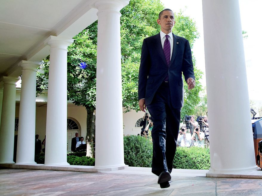 WALKING TALL: President Obama makes an exit after delivering a statement in the Rose Garden at the White House on Monday. Mr. Obama pushed for a Senate measure that would require more disclosure on campaign contributions. (Bloomberg)
