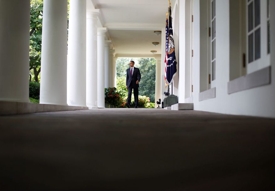 """President Obama exits the Oval Office on his way to the Rose Garden at the White House on Monday to deliver remarks on campaign finance reform. """"A vote to oppose these reforms is nothing less than a vote to allow corporate and special-interest takeovers of our elections. It is damaging to our democracy,"""" Mr. Obama said. (Associated Press)"""