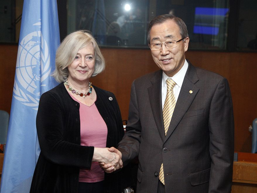 ** FILE ** In this Feb. 12, 2009 photo released by the United Nations, Inga-Britt Ahlehius, Under-Secretary-General for Internal Oversight Services, left, shakes hands with U.N. Secretary-general Ban Ki-moon at United Nations headquarters during a Compact Signing Ceremony for UN senior managers' compacts for 2009. Ms. Ahlehius, the head of the U.N.'s internal watchdog agency, stepped down, heightening the fears of U.S. and some U.N. officials that the much-derided effort to curb corruption in the world body will suffer further blows. (AP Photo/United Nations, Eskinder Debebe)
