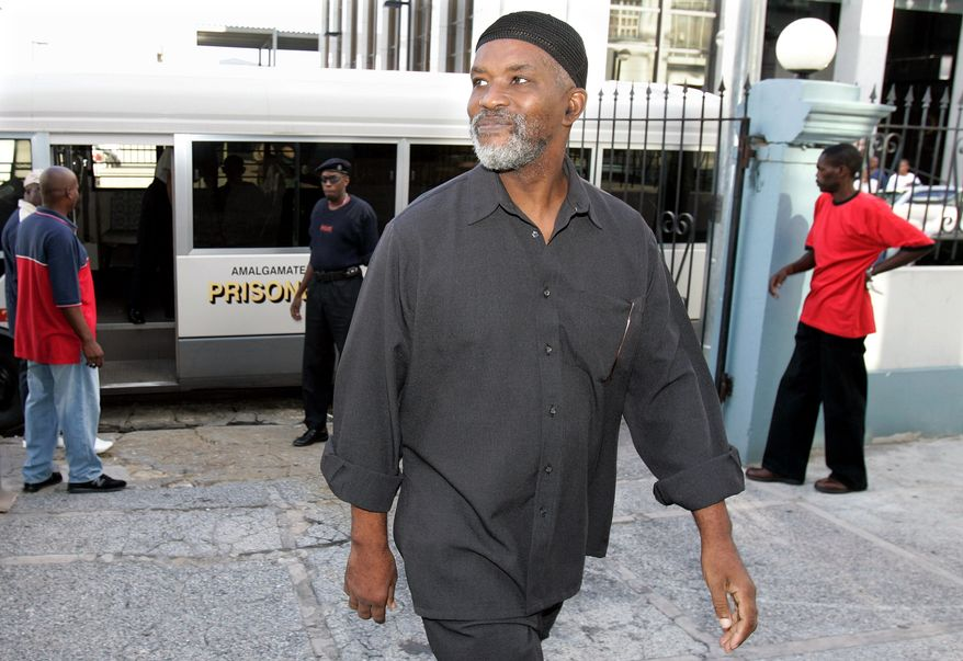 ** FILE ** Abdul Kadir, a former member of the Guyanese Parliament, arrives at the Magistrates' Court in downtown Port-of-Spain, Trinidad, in 2007 for an extradition hearing. A New York jury is hearing closing arguments in a terrorism case in which Mr. Kadir and another man are accused of plotting to blow up John F. Kennedy International Airport. (AP Photo/Andres Leighton)
